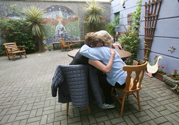 Image of two people hugging at Cork Simons emergency shelter.